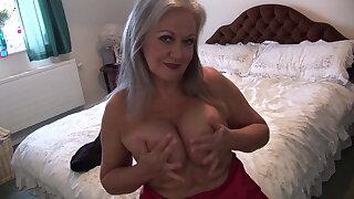 Busty elegant granny in slip and stocking spreads